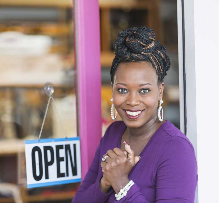 Business owner in front of her store that relies on On Line Support's IT services and data backups